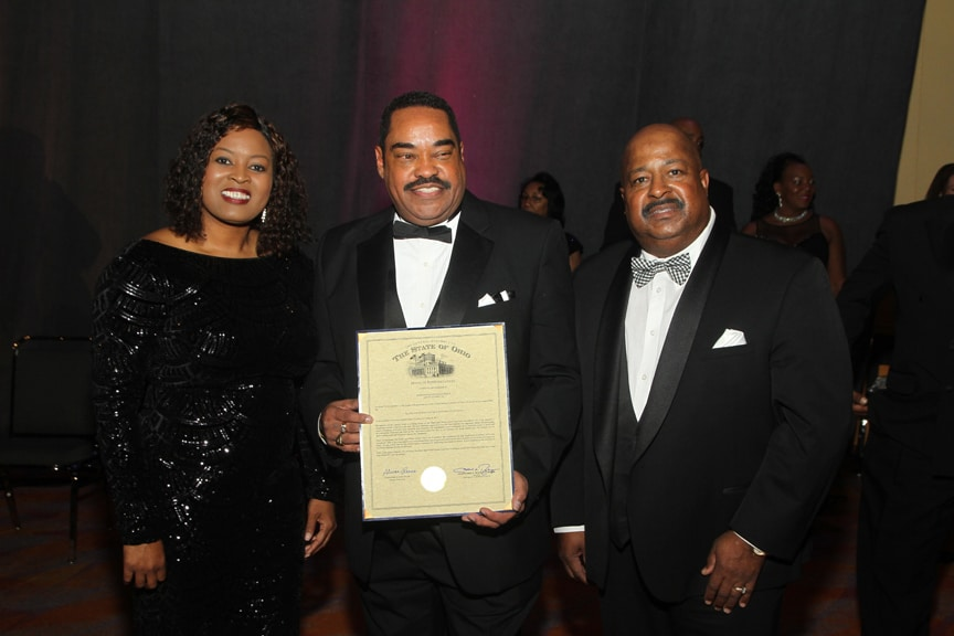 Dr.-Melvin-receives-proclamation-from-Representative-Alicia-Reece