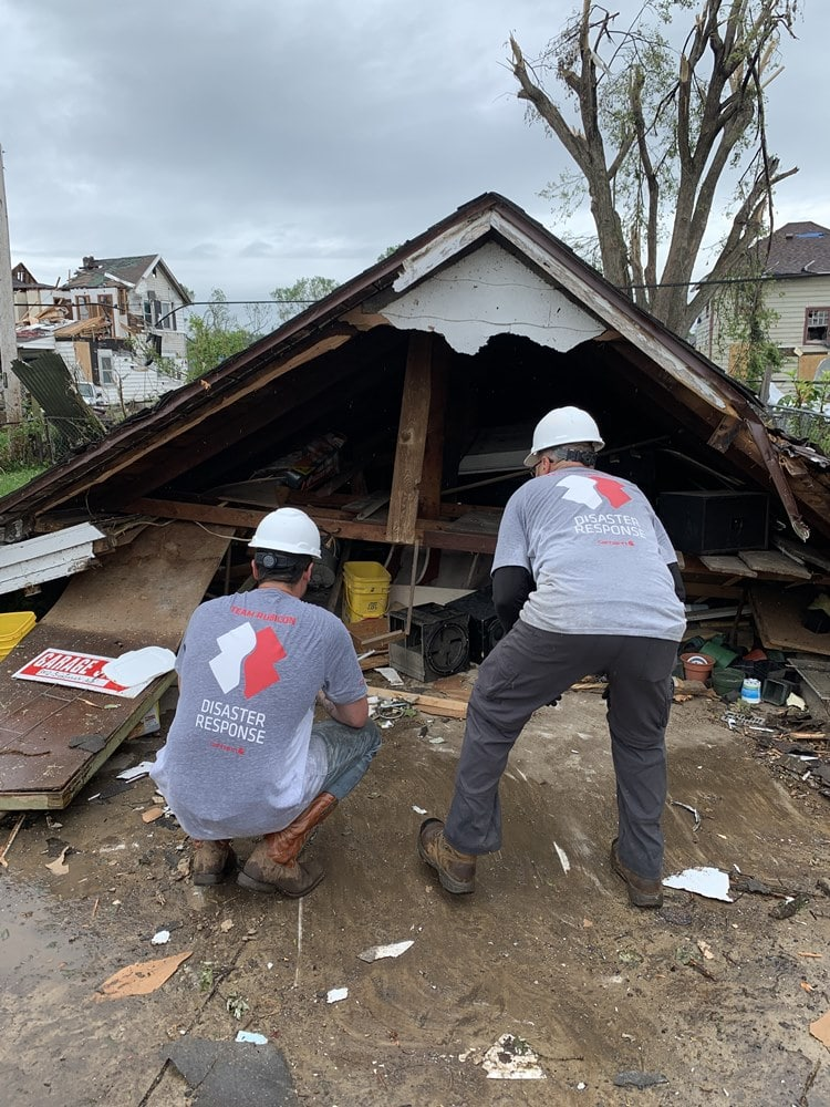 Team Rubicon members remove tornado debris