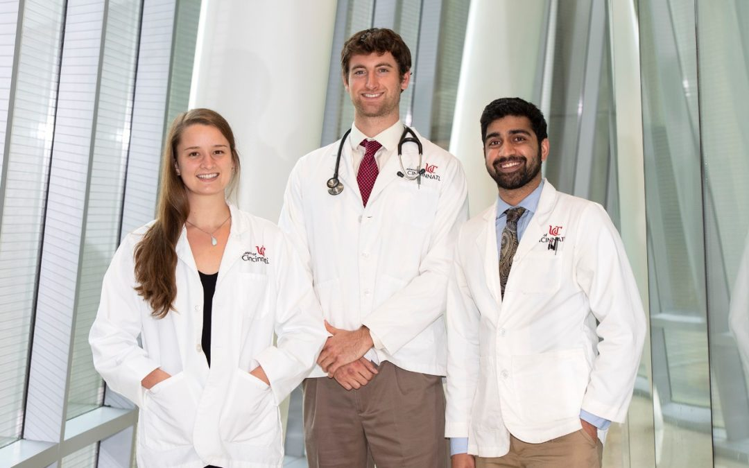 Medical students Caroline Hensley, Matthew Fry and Shawn Krishnan are shown in the UC College of Medicine.