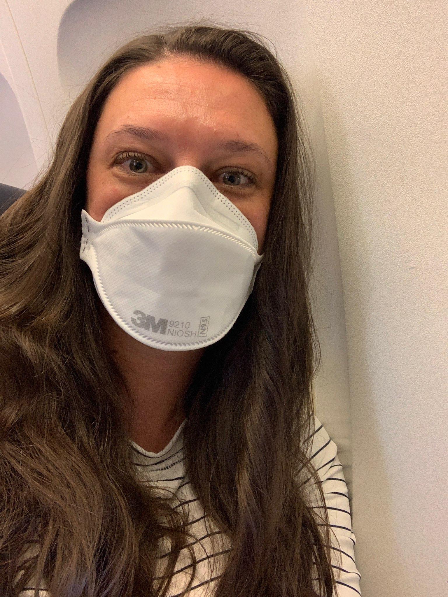 Christa Hyson wears an N-95 mask